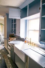 how to paint kitchen cabinets with spray gun how to paint kitchen cabinets with a paint sprayer at home