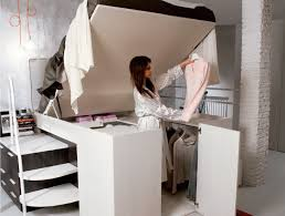 smart space saving bed hides a walk in closet underneath space