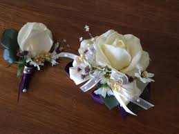 corsage and boutonniere cost ivory or purple wrist corsage and boutonniere