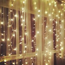 hanging white lights sheer curtains