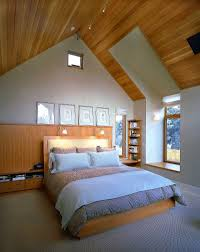 bedroom retro style attic with king sized bed and striped sheet