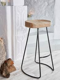 oak wood bar stools its top part has ergonomic design due to its curve and there s a