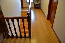 Bamboo Flooring Laminate Naturally Bamboo Flooring Throughout A Hallway And On Stairs