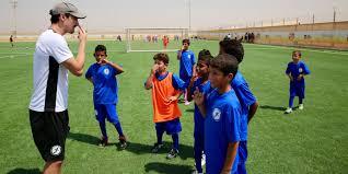 former pro soccer players kickstart joy in refugee camp