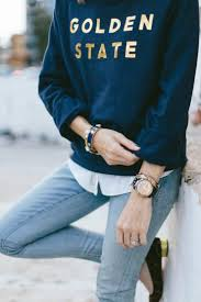 a golden state sweatshirt and jeans
