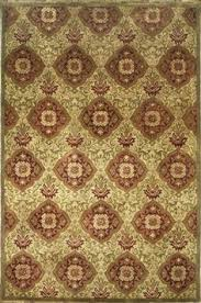 Area Rugs India Handmade And Tufted Circular Area Rug With Swirl Patterns In Brown