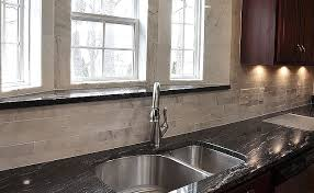 kitchen backsplash ideas with black granite countertops black granite and cabinets lighten up kitchen with white