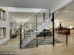 contemporary staircase with hardwood floors high ceiling in contemporary staircase with columns hardwood floors goldman stair railing high ceiling floating