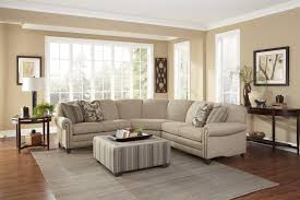 stationary sectional with rolled arms and nail head trim by smith