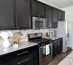 kitchen backsplash ideas black cabinets cabinets white and gray granite countertops and
