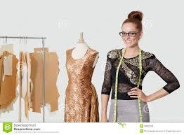 fashion designer portrait of beautiful fashion designer standing with