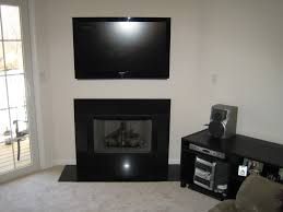 black tone fire place box combined wall mounted flat screen tv on