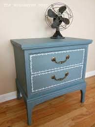 blue nightstand with a little design the weathered door