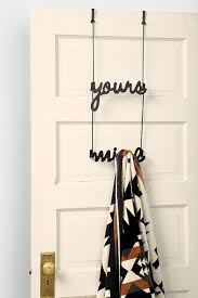 dorm room decor 101 surviving a tiny bathroom the finishing touch yours mine over the door rack