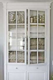 white linen cabinet with doors vintage white cabinet with glass doors for linen storage happy