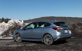 blue subaru hatchback compact hatchback comparison test cruze impreza civic and