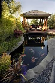 backyard with koi pond and gazebo beautiful koi pond as water