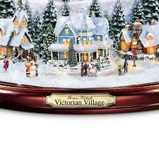 kinkade illuminated musical snow globe by