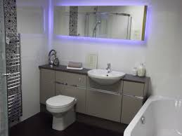 white futuristic fitted bathroom furniture with wall mounted