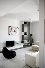 white studio apartment design with creative wall storage ideas and