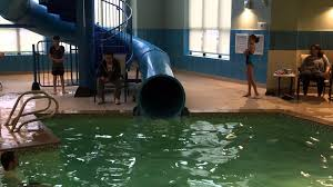 ideas water slide and indoor pool design with tile floorings also