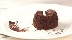 chocolate fondant served with sweet berry sauce stock footage