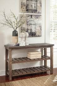 rustic casual sofa table with 2 slatted shelves by signature