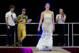 video students in trashion show model high fashion from low