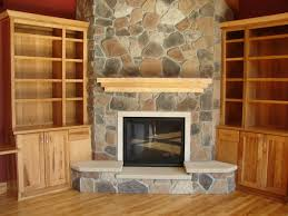 stone fireplace base added by brown wooden mantel shelf and