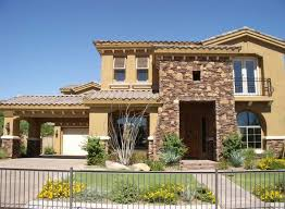 tuscan style house with dark cream wall and crumbling stone patios