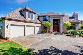 Cost Of Overhead Garage Door Cost To Install Or Replace An Overhead Garage Door Estimates And