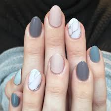 a marble accent paired with an ombré mani nailart over nails in