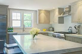 white kitchen cabinets with gray glaze white glazed crackle tiles with glossy gray cabinets