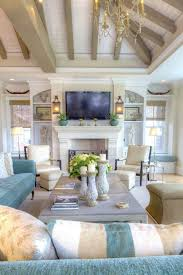 beach house interior living room with wall sconces and chandelier