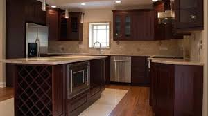 cherry wood kitchen cabinets with black granite marble countertops