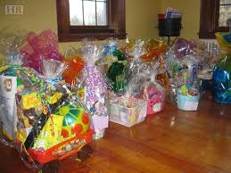 filled easter baskets newcomers club organizes a successful easter basket project