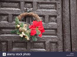 christmas reef decoration on wooden door stock photo royalty free