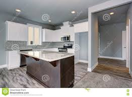 grey and white kitchen interior with dark brown kitchen island