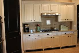kitchen cabinet toe kick black paint the toe kicks black and add bun to cabinets