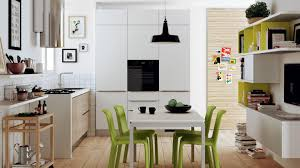 small kitchen layout design with white wooden dining table the
