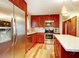 small kitchen with hardwood floor cherry cabinets and steel