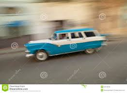 blue station wagon a speeding blue and white 1955 ford station wagon driving through