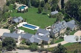 kim kardashian and kanye west move into 20 million mansion in