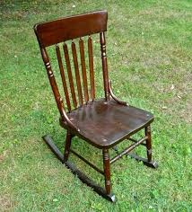 furniture old age varnished wooden rocking armless chair with