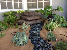 boulder fountain dry river bed hawkeye landscape design