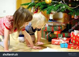 two adorable looking gifts stock photo 211839097