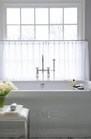 Bathtub Curtains Waterworks Bathtub Under Window Dressed In White Cafe Curtains