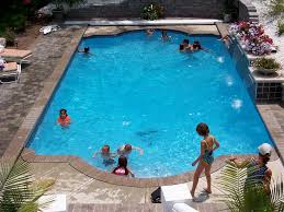 a pool in pool auto cover system creates a rectangle step all the