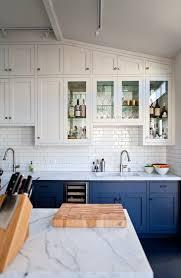 kitchen cabinet marble top subway tile kitchen backsplash blue cabinet white marble top