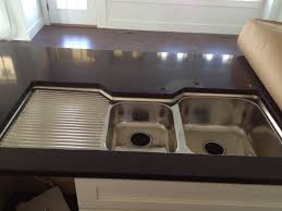 double stainless steel kitchen sink with drainboard on the left